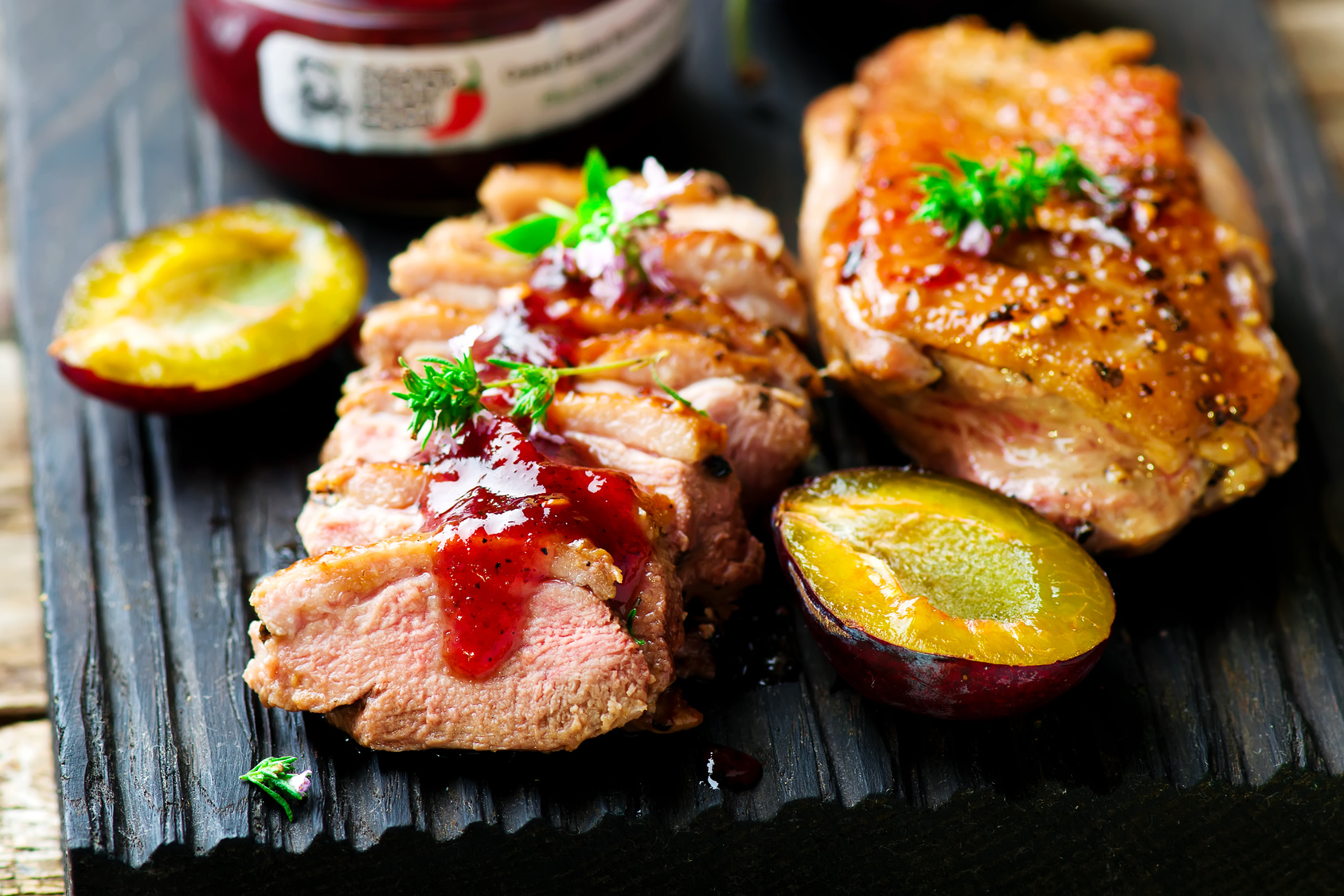 fried duck breast with plum sauce. selective focus