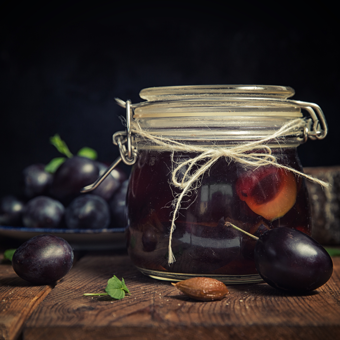 Plum compote in jar