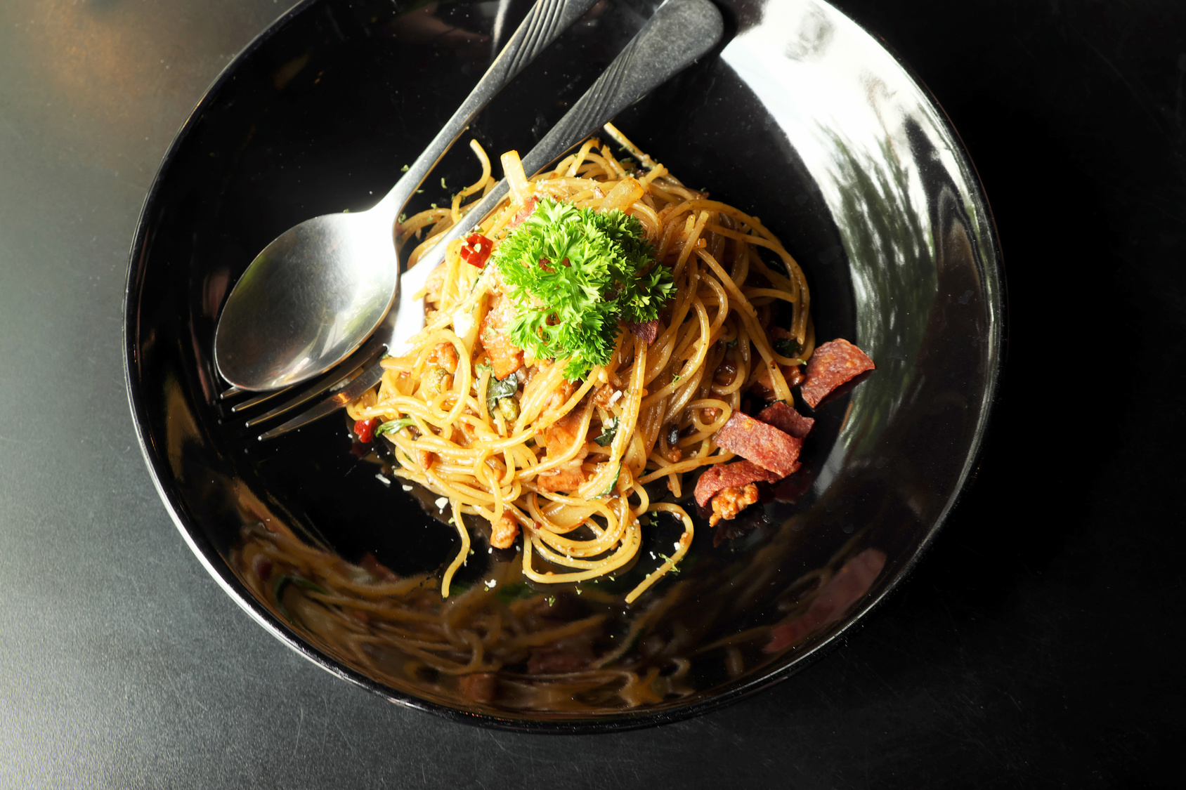 Spicy Spaghetti with Fried Ham in Black Plate